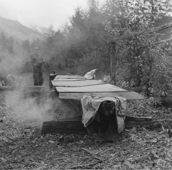 Charlie Mack keeps watch over his steaming canoe. Photo copyright Dorothy Kennedy from the Lil'wat World of Charlie Mack