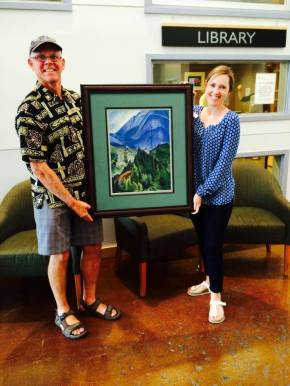 "Dave Perfitt donates a print of Emily Carr's ""Pemberton Meadows"" to the Pemberton Library."