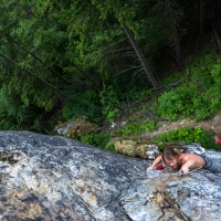 June 14's photo moment from Polek Rybczynski captures pro skier Chad Sayers rockclimbing in Pemberton